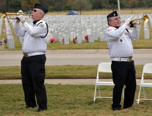 "Robert Kinkade (left) and Robert Ramirez (right) from the Fort Sam Houston Memorial Services Detachment  render ""Taps"" at the conclusion of the Fort Sam Houston National Cemetery Veterans Day Ceremony Nov. 11."