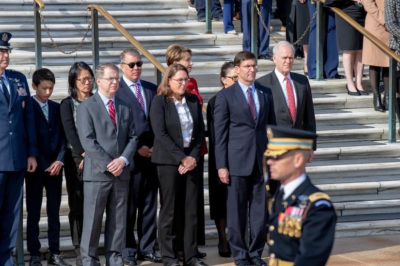 Defense Secretary Dr. Mark T. Esper and Deputy Defense Secretary David L. Norquist stand in a crowd.