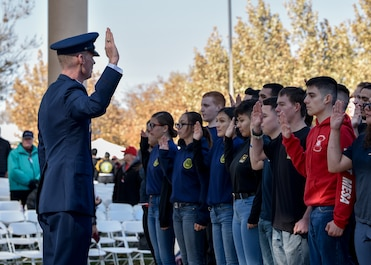 U.S. Air Force Col. David S. Miller (left), administers the Oath of Enlistment in Albuquerque at the New Mexico Veterans Memorial Nov. 11, 2019. Approximately 40 recruits participated and are ready to ship to basic military training. (U.S. Air Force photo by Airman 1st Class Austin J. Prisbrey)