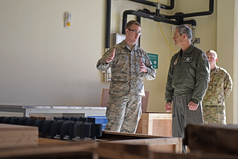 U.S. Air Force Staff Sgt. Thomas Herriott, 8th Maintenance Squadron munitions specialist, talks with Lt. Gen. Ken Wilsbach, 7th Air Force commander, about innovative solutions to munitions storage and transportation during a base visit to Kunsan Air Base, Republic of Korea, Nov. 8, 2019. During his visit, Wilsbach also had the opportunity to speak with first-term Airmen, tour the 8th Security Forces Squadron Military Working Dog kennels. (U.S. Air Force photo by Staff Sgt. Mackenzie Mendez)