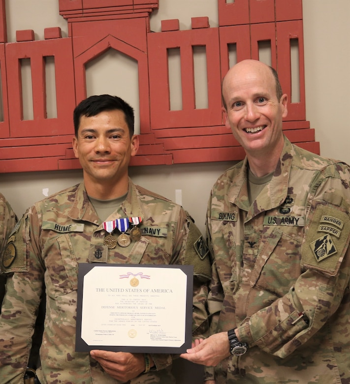 Chris Becking, USACE Afghanistan District Commander presents the Meritorious Service Medal to Navy Chief Petty Officer Thomas J. Hume.