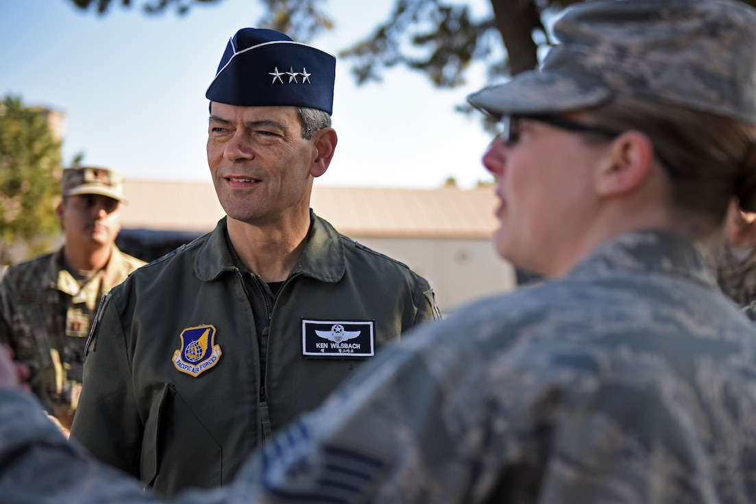 U.S. Air Force Lt. Gen. Ken Wilsbach, 7th Air Force commander, speaks with Staff Sgt. Loren Boring, 8th Civil Engineer Squadron craftsman, during a base visit at Kunsan Air Base, Republic of Korea, Nov. 7, 2019. Wilsbach learned about how the 8th Civil Engineer Squadron is paving the way for future Airmen to operate and accomplish their mission in safer and healthier environments. (U.S. Air Force photo by Staff Sgt. Mackenzie Mendez)
