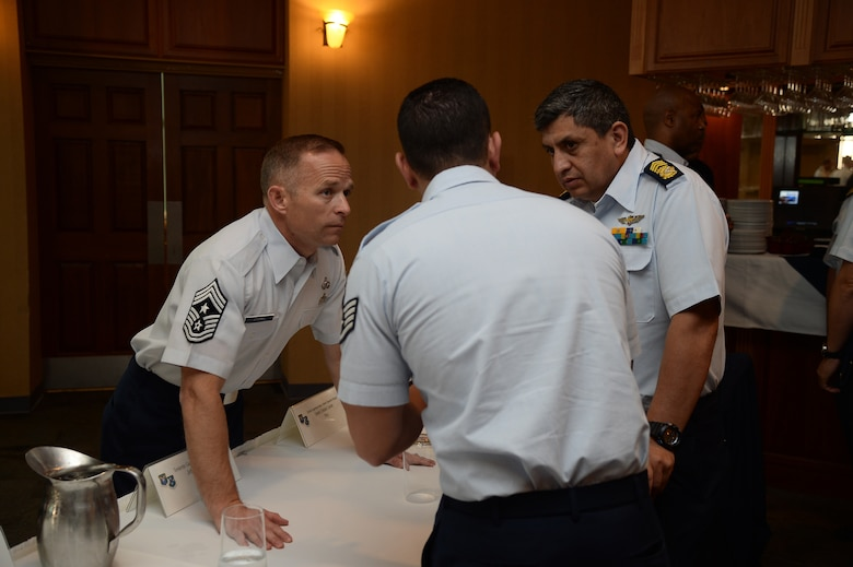 Photo of members of the South American Air Chiefs and Senior Enlisted Leaders Conference talk