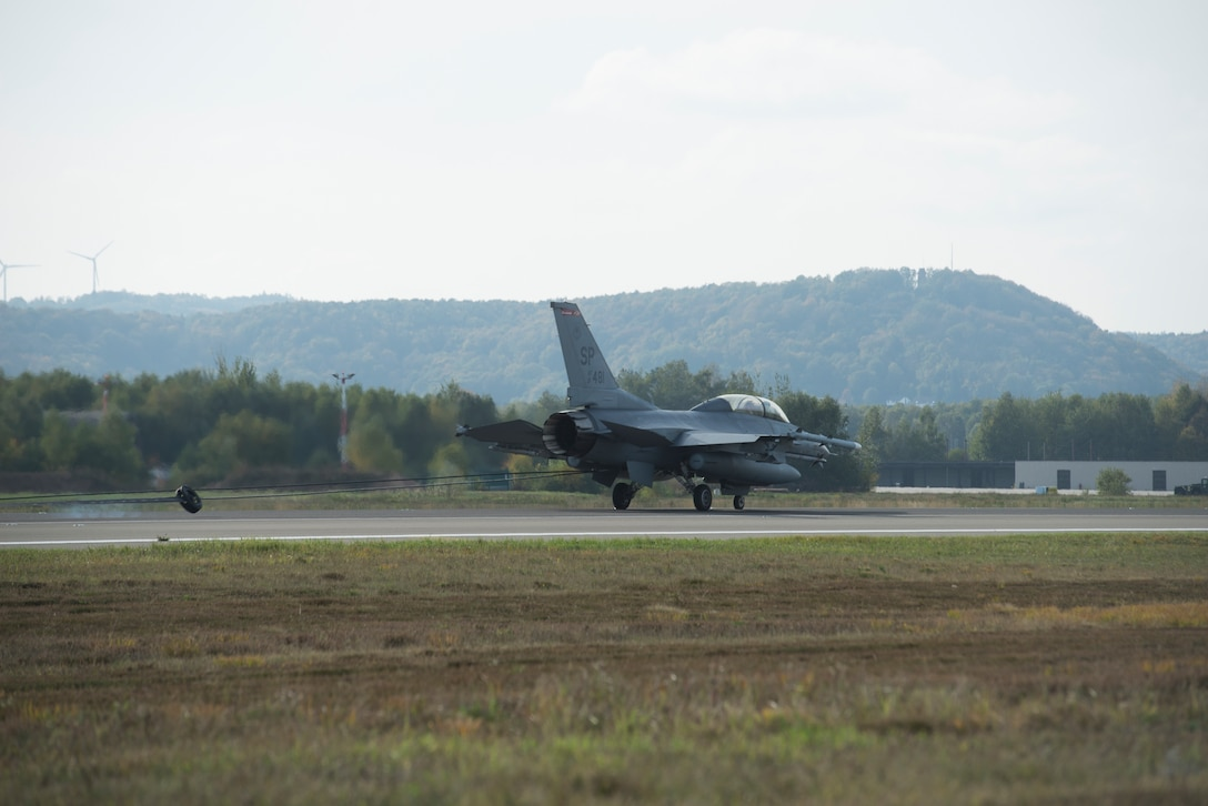 An U.S. Air Force F-16 Fighting Falcon assigned to Spangdahlem Air Base, Germany rests after hooking onto the aircraft arresting system at Ramstein Air Base, Germany, Oct. 28, 2019. Ramstein AB is annually certified on aircraft arresting systems in the event other bases may need to use them.
