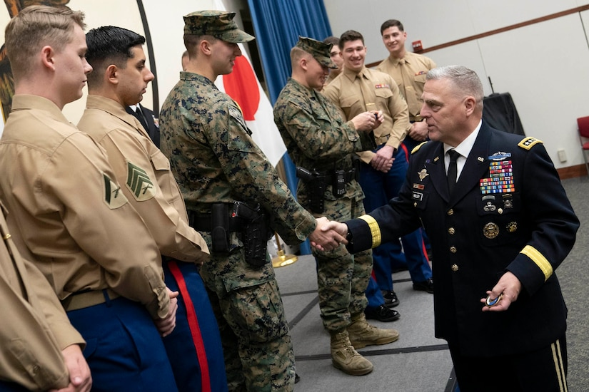 Army Gen. Mark A. Milley shakes hands with troops.
