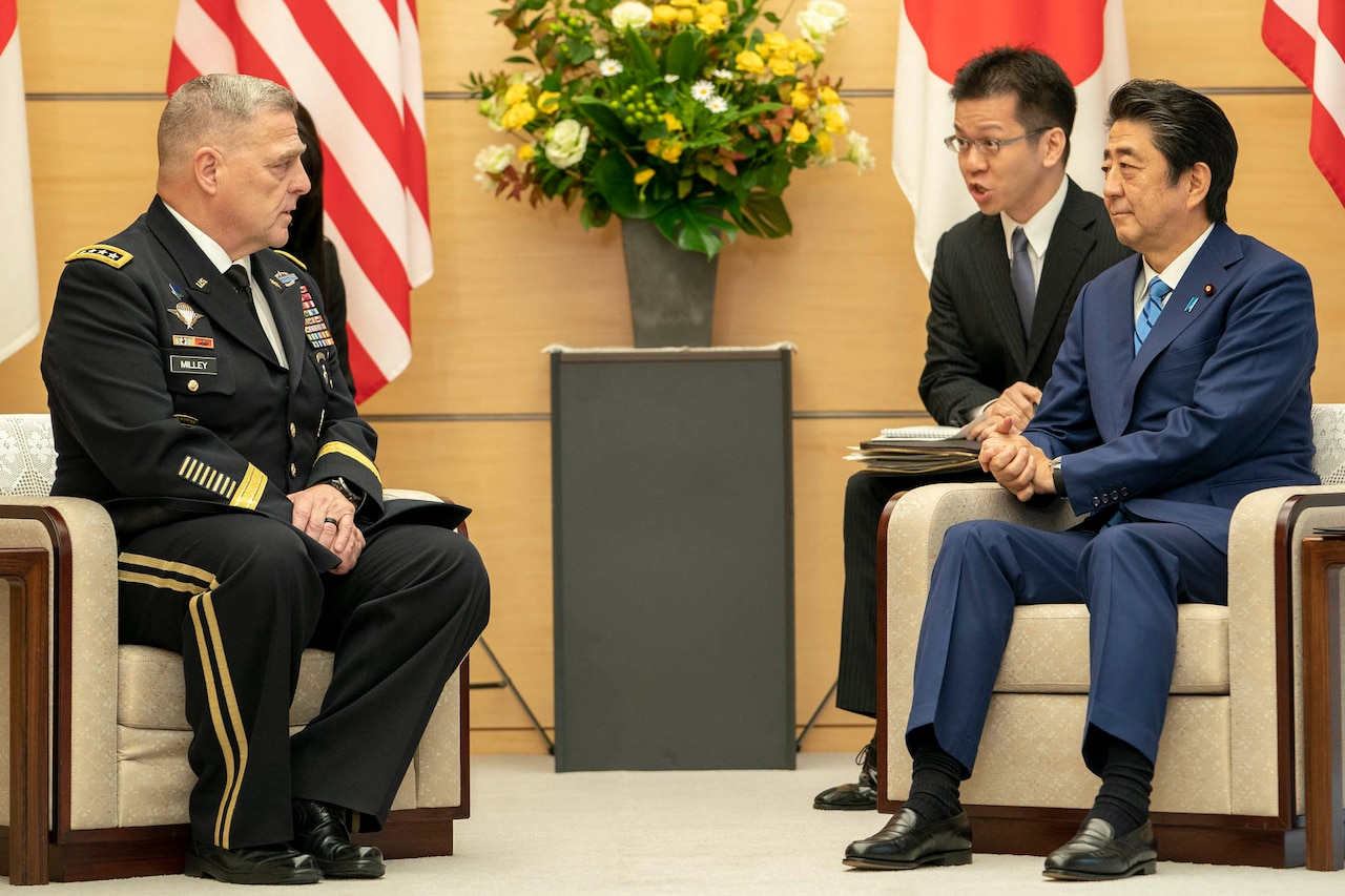 Army Gen. Mark A. Milley, chairman of the Joint Chiefs of Staff, sits next to Japanese Prime Minister Shinzo Abe.