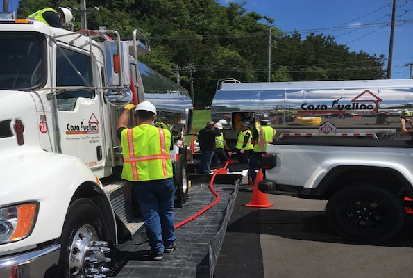 DLA Energy fuel contractors perform truck-to-truck transfer operations and prepare for truck-to-vehicle fueling operations