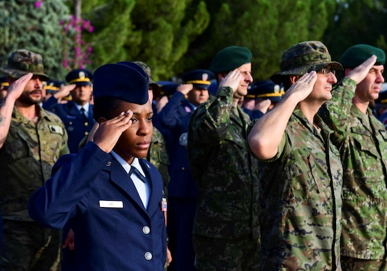 U.S., Turkish, Spanish, Qatari service members from across the base render a salute during the Ataturk Memorial Day Ceremony Nov. 10, 2019, at Incirlik Air Base, Turkey. The ceremony brought members from across the base together to honor Ataturk, the founder and first president of modern Turkey.