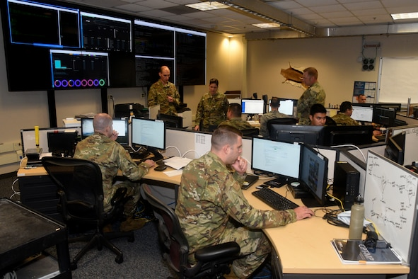 Members of the 175th Cyberspace Operations Group participate as a Service Aligned Cyber Protection Team at a 3000-level certification event, Sept. 20, 2019, at Martin State Airport, Middle River, Md. The event, Green Dragon, was the first time a Cyber Protection Team organically hosted this type of event at a home station. (U.S. Air National Guard photo by Staff Sgt. Enjoli Saunders)