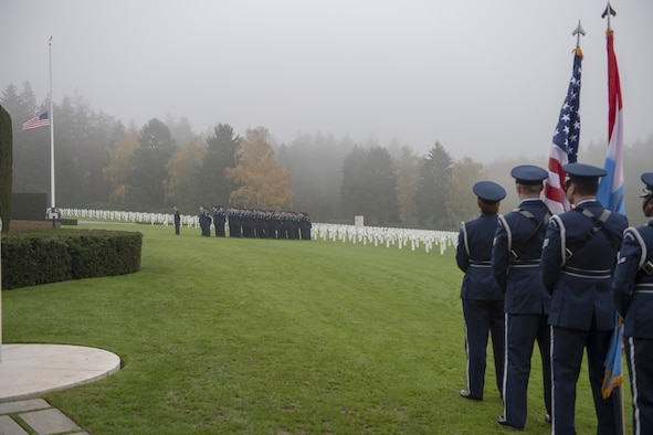 Members from the U.S. Air Force 52nd Fighter Wing and 726th Air Mobility Squadron stand in formation during the Veteran's Day ceremony at the Luxembourg American Cemetery in Hamm, Luxembourg, Nov. 11, 2019. Several dozen volunteers from the 52nd FW and 726th AMS participated in a Veteran's Day service at the cemetery. (U.S. Air Force photo by Airman 1st Class Branden Rae)