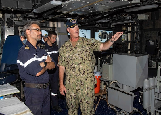 U.S. Navy Capt. Chris. D. Stone, the commanding officer of the guided-missile cruiser USS Normandy (CG 60), gives a tour of the ship's pilot house to the commanding officer of the French Navy ship Jean Bart during International Maritime Exercise 2019 (IMX 19). The exercise is a multinational engagement involving partners and allies from around the world designed to facilitate the sharing of knowledge and experiences across the full spectrum of defensive maritime operations. IMX 19 serves to demonstrate the global resolve in maintaining regional security and stability, freedom of navigation and the free flow of commerce from the Suez Canal south to the Bab el-Mandeb Strait through the Strait of Hormuz to the Northern Arabian Gulf. (U.S. Navy photo by Mass Communication Specialist 2nd Class Michael H. Lehman)