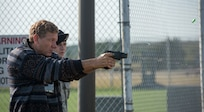 Dave Heller, a participant of the Joint Civilian Orientation Conference, uses a Taser gun at Joint Base Langley-Eustis, Virginia, Nov. 7, 2019.