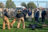 Joint Civilian Orientation Conference participants watch a 633rd Security Forces Squadron military working dog demonstration at Joint Base Langley-Eustis, Virginia, Nov. 7, 2019.