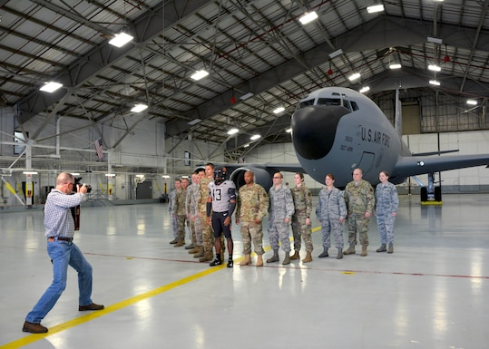 An Oklahoma State University video crew visits the 507th Air Refueling Wing and takes footage of their military appreciation uniform with and in a KC-135R Stratotanker Oct. 9, 2019, at Tinker Air Force Base, Oklahoma.