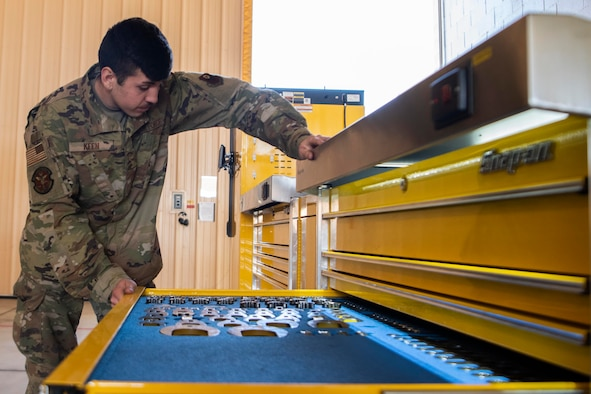 Airman 1st Class Rodney Keen, 20th Air Maintenance Unit CV-22 Osprey aircraft crew chief, opens a tool drawer at Cannon Air Force Base, N.M., Nov. 5, 2019. So far the kit has saved, on average, one hour per shift when it comes to checking out toolboxes and tools.  (U.S. Air Force photo by Senior Airman Gage Daniel)