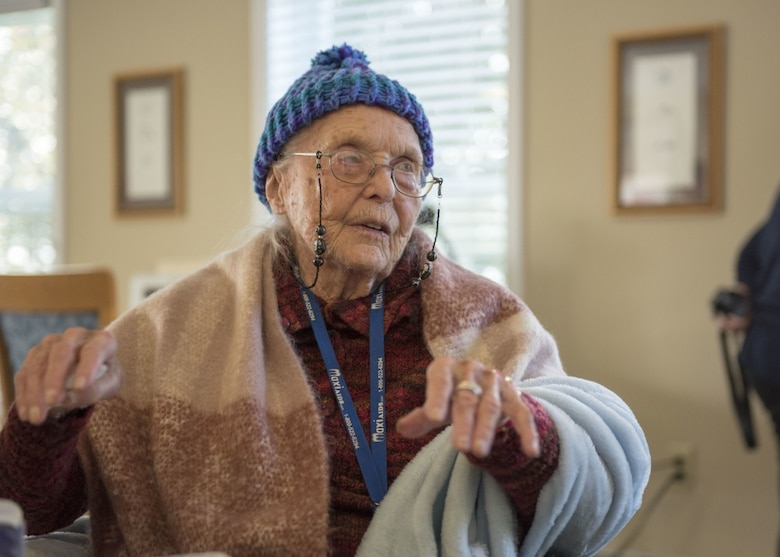 U.S. Air Force Airmen from the Massachusetts Air National Guard's 102nd Intelligence Wing wish fellow Airman, U.S. Army Air Corps veteran Della Sassa a happy 102nd birthday at the Royal Cape Cod Nursing and Rehabilitation Center in Buzzards Bay Mass. on November 8, 2019. (U.S. Air National Guard photo by Tech. Sgt. Thomas Swanson)