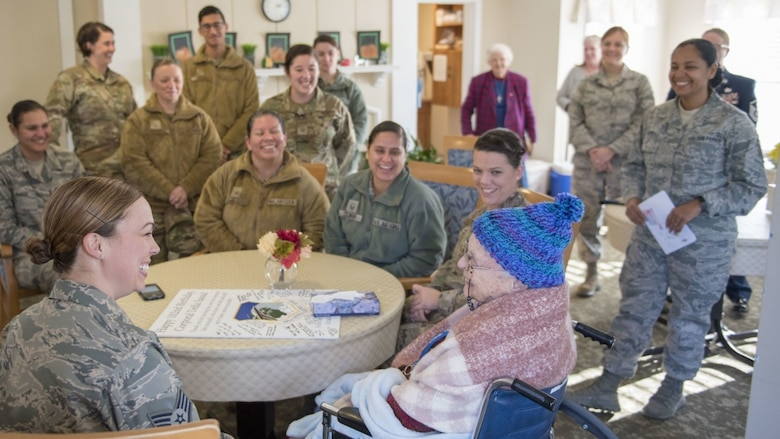 U.S. Air Force Airmen, assigned to the Massachusetts Air National Guard's 102nd Intelligence Wing, wish fellow Airman, U.S. Army Air Corps veteran Della Sassa a happy 102nd birthday at the Royal Cape Cod Nursing and Rehabilitation Center in Buzzards Bay Mass. on November 8, 2019. (U.S. Air National Guard photo by Tech. Sgt. Thomas Swanson)