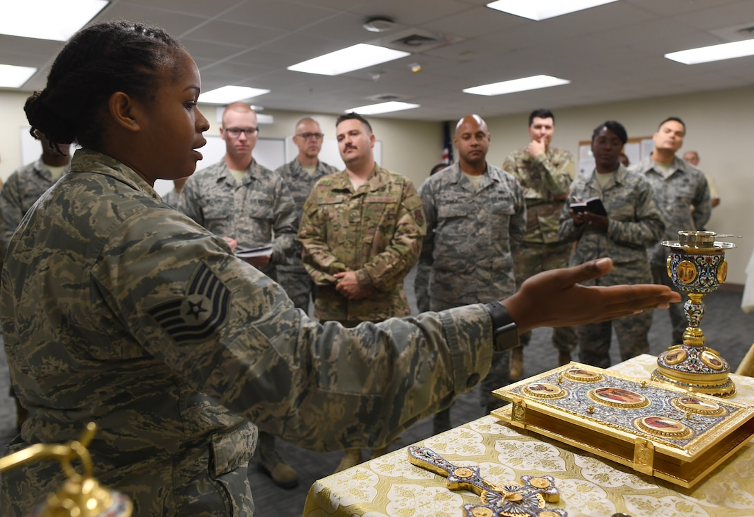 U.S. Air Force Tech. Sgt. Keesha Green, 335th Training Squadron religious affairs instructor, explains the Orthodox faith group set up during the religious affairs course inside Allee Hall at Keesler Air Force Base, Mississippi, Oct. 17, 2019. The six-week-long technical training course has been relocated and revamped to improve the training of their enlisted Airmen. (U.S. Air Force photo by Kemberly Groue)