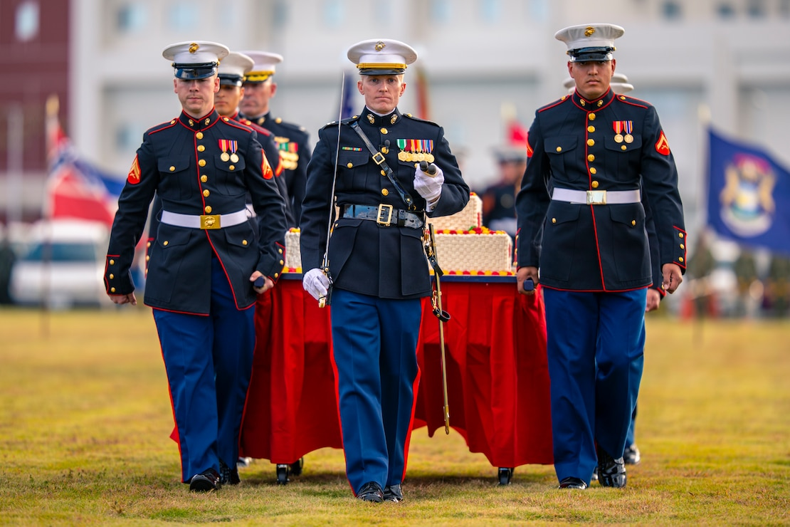 U.S. Marines and Sailors from Marine Corps Air Station Iwakuni, take part in the 244th Marine Corps birthday uniform pageant at Marine Corps Air Station Iwakuni, Japan, Nov. 4, 2019. The annual ceremony was held in honor of the 244th Marine Corps birthday. It included a historical uniform pageant to honor Marines of the past, present and future while signifying the passing of traditions from one generation to the next.