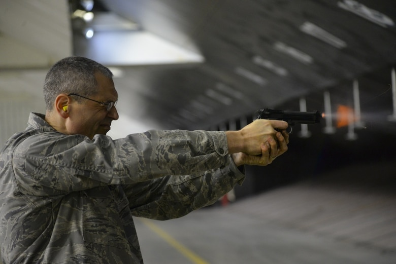 U.S. Air Force Lieutenant Colonel Eric Erickson, the Medical Group commander from the 177th Fighter Wing, New Jersey Air National Guard, fires the M9 pistol during weapons qualification training at the Transportation Security Administration firing range in Egg Harbor Township, N.J. on Nov. 5, 2019. Erickson, along with the 177th Fighter Wing commander and group commanders, took the security forces proficiency fire course, to experience a base Defender's job. (U.S. Air National Guard photo by Senior Master Sgt. Andrew J. Moseley)