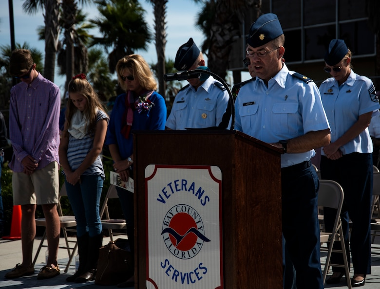 Maj. Mark Juchter, 325th Fighter Wing Religious Affairs chaplain, delivers an invocation at the annual Veterans Day parade celebration and wreath laying ceremony on Nov. 11, 2019, at Panama City, Florida. The annual event celebrated those who served in the past and to honor the sacrifices made by the service member as well as their families, both at home and abroad. (U.S. Air Force photo by Staff Sgt. Magen M. Reeves)
