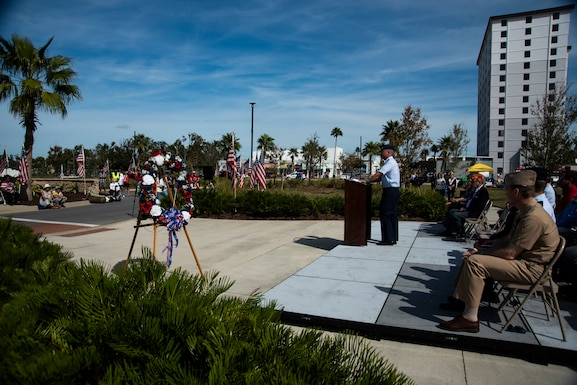 Col. Brian Laidlaw, 325th Fighter Wing commander, delivers a speech at the annual Veterans Day parade celebration and wreath laying ceremony on Nov. 11, 2019, at Panama City, Florida. The annual event celebrated those who served in the past and to honor the sacrifices made by the service member, as well as their families, both at home and abroad. Laidlaw thanked many local community members who served in prior conflicts and also thanked Bay County for supporting their veterans. (U.S. Air Force photo by Staff Sgt. Magen M. Reeves)