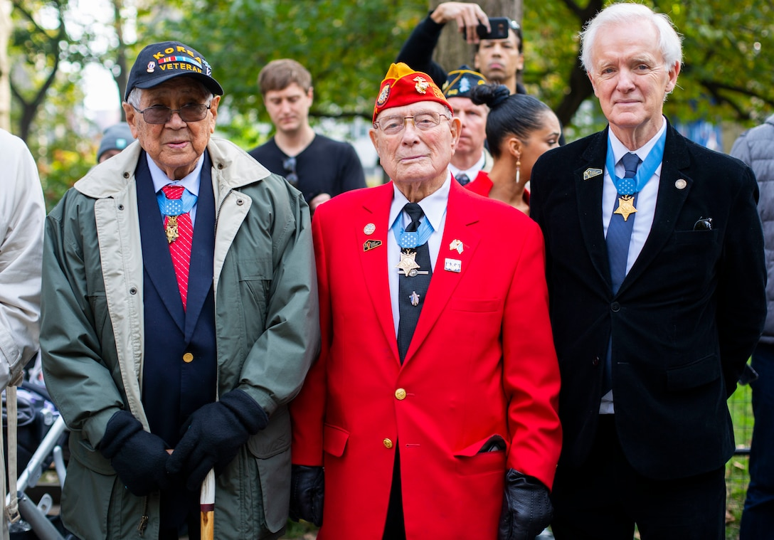 "Medal of Honor recipients and grand marshals of the 2019 New York City Veterans Day Parade Army Staff Sgt. Hiroshi ""Hershey"" Miyamura, Marine Corps Chief Warrant Officer Four Hershel ""Woody"" Williams and former Senator Bob Kerrey are pictured during the parade. The 2019 parade marked its centennial anniversary and honored the Marine Corps as its featured service. Formed Nov. 10, 1775, as naval augment forces capable of fighting both at sea and on shore, the Marine Corps has secured freedom in every major conflict America has faced. Together, the Navy-Marine Corps Team enables the joint force to partner together and operate on behalf of national defense in this era of great power competition. Steeped in the core values of honor, courage and commitment, Marines bring moral, physical, and intellectual strength to every situation. When their time in uniform is done, Marines use those qualities to continue to serve their communities."