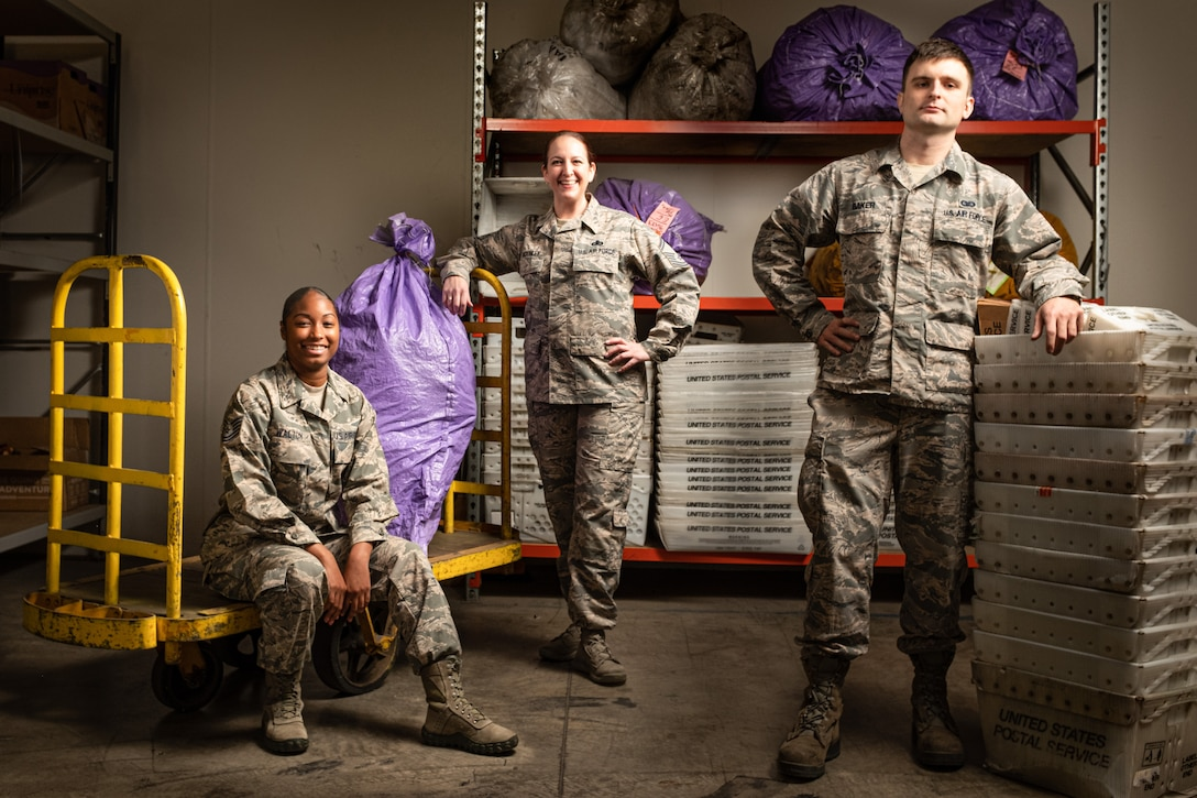 Members of the Pacific Air Forces Air Postal Squadron Detachment 4 pose for a group photo in this composite image in Sydney August 24, 2019. The detachment is responsible for delivering mail to government employees and their families located across an area of more than 3 million square miles. (U.S. Air Force Photo Illustration by Master Sgt. Benjamin Wilson)