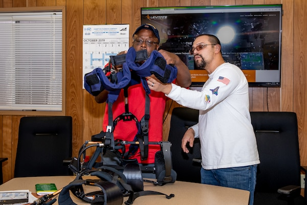Code 900F.12 Safety Repair Work Leader Daniel Freeney Sr. and his team test the weight and design of the Levitate Airframe exoskeleton suit.