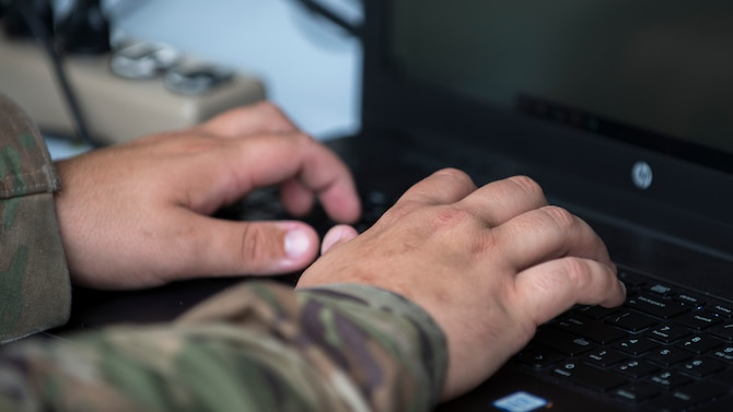 U.S. Air Force Staff Sgt. Kalen Diaz, a 6th Contracting Squadron (CONS) contract specialist, types an e-mail for a contract request at MacDill Air Force Base, Fla., Nov. 5, 2019.