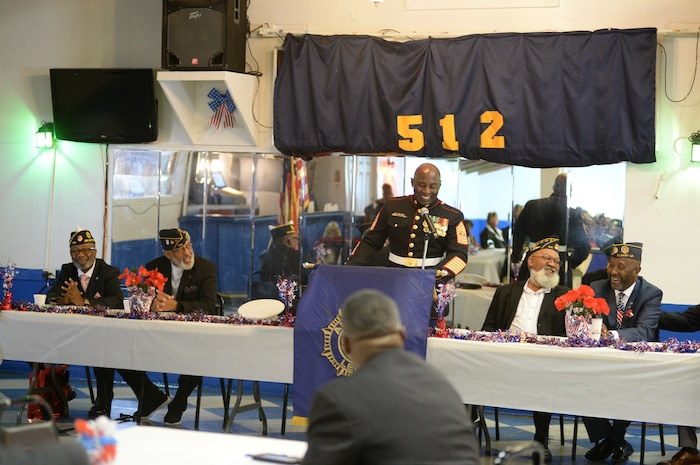 One day after celebrating the Marine Corps' 244th birthday, a few Marines from Marine Corps Logistics Base Albany celebrated Veterans Day with the local community, Nov. 11.  Sgt. Maj. Jeffrey Young, sergeant major, MCLB Albany, was the guest speaker at the American Legion Post 512.  He told the near-capacity crowd that he was honored to be given the opportunity to share his perspective on the importance of the day.