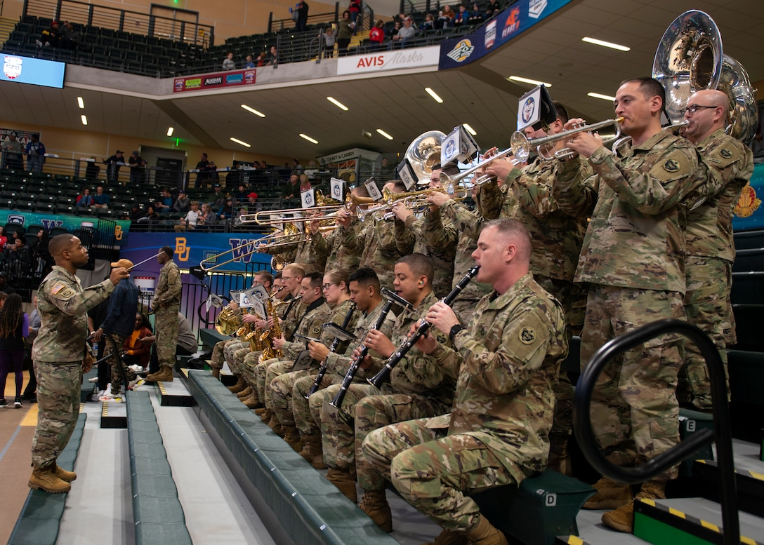 The 9th Army Band performs before the ninth annual Armed Forces Classic at the Alaska Airlines Center in Anchorage, Alaska, Nov. 8, 2019. ESPN hosted the event in partnership with Joint Base Elmendorf-Richardson, Alaska. Every year, the Armed Forces Classic travels to a new military location around the world. The Marine Corps will host the 2020 Armed Forces Classic at Camp Lejeune, North Carolina.