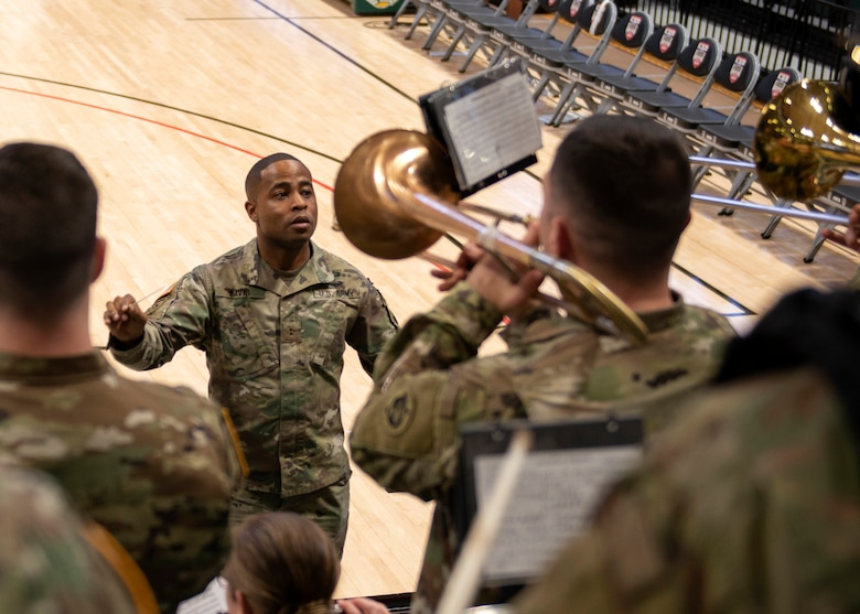 Chief Warrant Officer 2 Alexander Davis, 9th Army Band commander conductor, conducts before the ninth annual Armed Forces Classic at the Alaska Airlines Center in Anchorage, Alaska, Nov. 8, 2019. ESPN hosted the event in partnership with Joint Base Elmendorf-Richardson, Alaska. Every year, the Armed Forces Classic travels to a new military location around the world. The Marine Corps will host the 2020 Armed Forces Classic at Camp Lejeune, North Caro