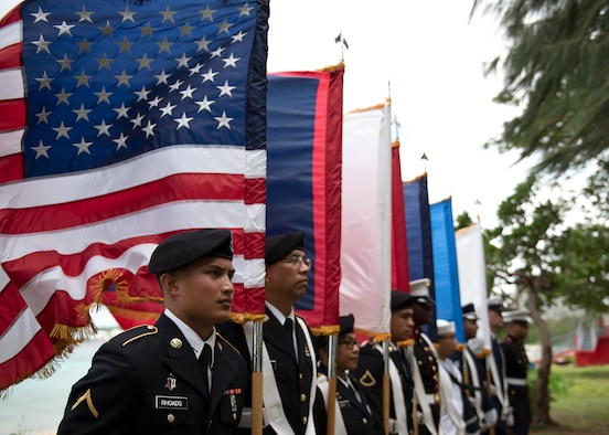 Members of the U.S. Joint Color Guard stand in formation prior to the start of the Veterans Day Ceremony Nov. 11, 2019 at Ypao Beach, Guam. The Veterans Day ceremony celebrated the service of all U.S. military veterans and coincides with Armistice Day and Remembrance Day which are celebrated in other countries, marking the anniversary of the end of World War I.