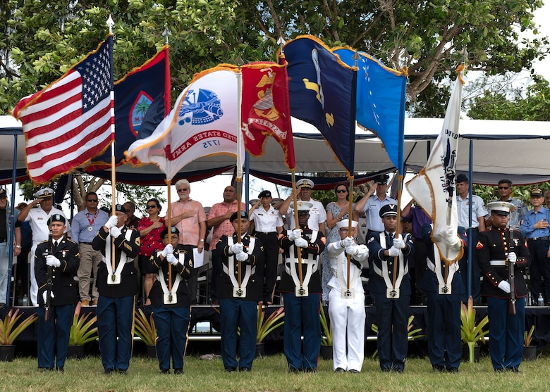 Members of the U.S. Joint Color Guard present the colors during the Veterans Day Ceremony Nov. 11, at Ypao Beach, Guam. On Veterans Day, Americans nationwide pay tribute to generations of men and women who have served and still serve in uniform.