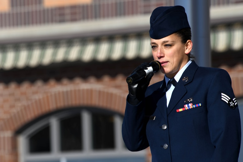 Senior Airman Rachael Karpo, 28th Operations Support Squadron Air Traffic Controller, speaks at the 2019 Veteran's Day Ceremony at Main Street Square in Rapid City, S.D., Nov. 11, 2019. Karpo sang the National Anthem as an opener for the ceremony and provided an anecdote of her military service to those in attendance. (U.S. Air Force photo by Staff Sgt. Hailey Staker)