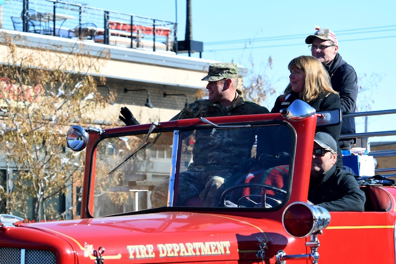 Col. David A. Doss, 28th Bomb Wing commander, and his spouse, Marlina, ride in the flagship fire truck during the 2019 Veteran's Day Parade on Main Street in Rapid City, S.D., Nov. 11, 2019. The Veteran's Day Ceremony and Parade celebrate and honor our nation's veterans, and included a flag ceremony by the Honor Guard. (U.S. Air Force photo by Staff Sgt. Hailey Staker)