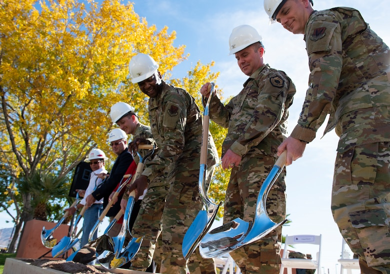 Nellis Air Force Base and City of Las Vegas leadership break ground on a new trauma center during a ceremony celebrating the Mike O'Callaghan Military Medical Center's 25th Anniversary on Nellis Air Force Base, Nevada, Nov. 12, 2019. The ground breaking marks the beginning of a three year endeavor for the MOMMC to become a level three trauma center. (U.S. Air Force photo by Senior Airman Kevin Tanenbaum)