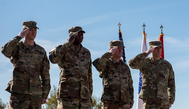 Members of Nellis leadership render a salute as the National Anthem plays during a ceremony celebrating the Mike O'Callaghan Military Medical Center's 25th anniversary at Nellis Air Force Base, Nevada, Nov. 12, 2019. During a ceremony that was attended by base and community leadership, the MOMMC celebrated O'Callaghan and 25 years of operations. (U.S. Air Force photo by Senior Airman Kevin Tanenbaum)