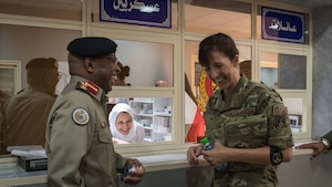 U.S. Air Force Col. Courtney Finkbeiner, right, 386th Expeditionary Medical Group commander, shares a laugh with Kuwaiti army Col. Homoud Alenezi, left, North Military Medical Complex assistant director, and a medical complex staff member in Al Jahra, Kuwait, Nov. 7, 2019. Leadership and staff members from the 386th EMDG visited the hospital to tour the facility and take part in a presentation for a continuiting medical education exchange. (U.S. Air Force photo by Tech. Sgt. Daniel Martinez)