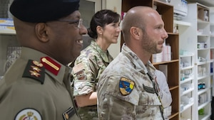 Leadership and staff members from the 386th Expeditionary Medical Group visit the pharmacy at the North Military Medical Complex in Al Jahra, Kuwait, Nov. 7, 2019. Kuwaiti army medics and leadership hosted Airmen from the 386th Expeditionary Medical Group providing a tour of the facility and inviting them to take part in a presentation for a continuiting medical education exchange. Left to right: Kuwaiti army Col. Homoud Alenezi, North Military Medical Complex assistant director; U.S. Air Force Col. Courtney Finkbeiner, 386th EMDG commander; Italian air force Lt. Salvatore Napolitano, Task Force Air-Kuwait flight surgeon. (U.S. Air Force photo by Tech. Sgt. Daniel Martinez)