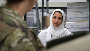 A Kuwait army medical facility staff member briefs members of the 386th Expeditionary Medical Group during a tour of the North Military Medical Complex in Al Jahra, Kuwait, Nov. 7, 2019. Kuwaiti army medics and leadership hosted Airmen from the 386th Expeditionary Medical Group providing a tour of the facility and inviting them to take part in a presentation for a continuiting medical education exchange. (U.S. Air Force photo by Tech. Sgt. Daniel Martinez)