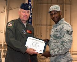 Man receiving diploma.