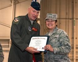 Woman receiving diploma.
