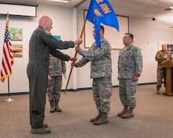 Guidon exchanged at change of command ceremony.
