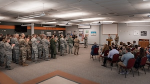 Unit pictured in change of command ceremony.