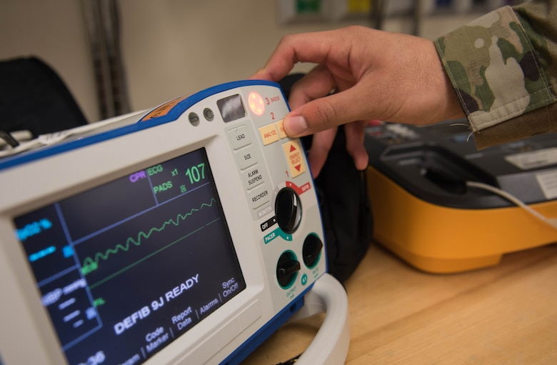 U.S. Air Force Airman 1st Class Timothy Torres, 633rd Medical Group biomedical equipment technician, turns on a defibrillator at Joint Base Langley-Eustis, Virginia, Nov. 8, 2019. Torres enjoys working as a BMET because he gets to do something new in his job each day. (U.S. Air Force photo by Airman 1st Class Sarah Dowe)