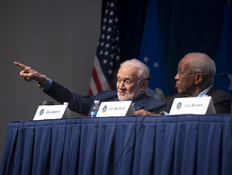Retired Air Force Col. Buzz Aldrin, the second man to walk on the moon, makes a point during a panel discussion by Air Force Institute of Technology alumni astronauts as part of the AFIT Centennial Symposium on Wright-Patterson Air Force Base, Ohio, Nov. 7, 2019. Retired Col. Guy Bluford, the first African-American in space, also took part in the panel that addressed how AFIT impacted their careers, the future of space and took questions from the audience. (U.S. Air Force photo by R.J. Oriez)