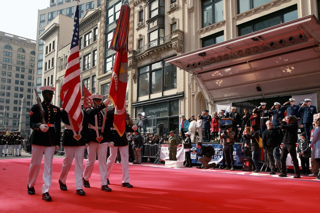 Marines with The U.S. Marine Corps Color Guard march during the 2019 Veteran's Day Parade in New York, New York, Nov. 11, 2019. The Veteran's Day Parade is hosted annually to commemorate the service and sacrifice of service members and their families.