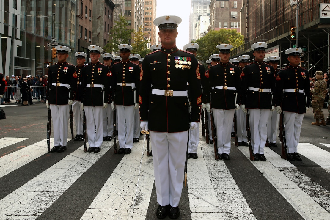 Marines with the U.S. Marine Corps Silent Drill Platoon stand at attention during the 2019 Veteran's Day Parade in New York, New York, Nov. 11, 2019. The Veteran's Day Parade is hosted annually to commemorate the service and sacrifice of service members and their families.